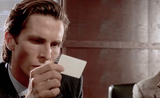 Bateman looking at business card, from 'American Psycho'